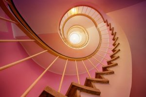 Spiral staircase in a pink walled house