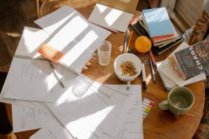 courses spread out on a table to study, revise