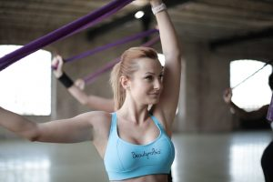 Woman doing sport with elastic band
