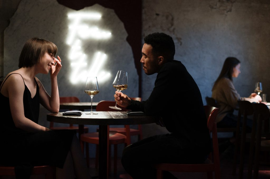 Romantic date in a restaurant, a couple drinking wine