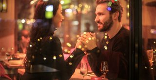 Romantic date of a couple in a restaurant